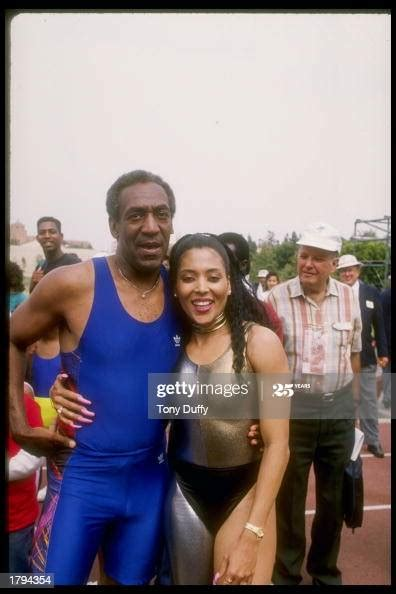 Florence Griffith-Joyner poses for a picture with Bill