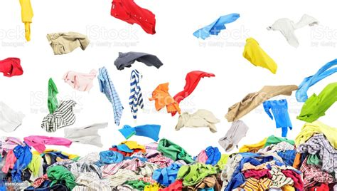 Separate Clothing Falling At The Big Pile Of Clothes On A
